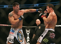 September 22, 2012; Toronto, ON, CANADA; Brian Stann (left) punches at Michael Bisping (right) in the middleweight championship during UFC 152 at the Air Canada Centre. Mandatory Credit: Tom Szczerbowski-USA TODAY Sports