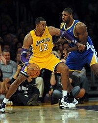 November 9, 2012; Los Angeles, CA, USA;  Golden State Warriors center Festus Ezeli (31) defends Los Angeles Lakers center Dwight Howard (12) in the first half of the game at the Staples Center. Mandatory Credit: Jayne Kamin-Oncea-USA TODAY Sports