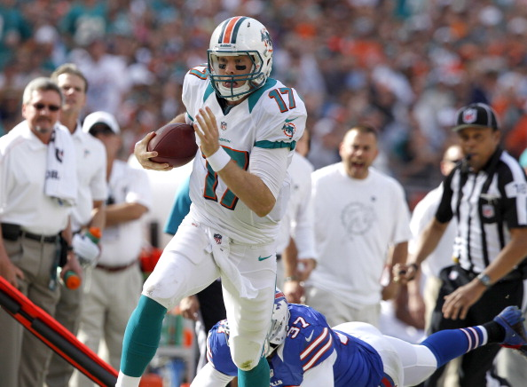 MIAMI GARDENS, FL - DECEMBER 23: Ryan Tannehill #17 of the Miami Dolphins runs with the ball against the Buffalo Bills on December 23, 2012 at Sun Life Stadium in Miami Gardens, Florida. The Dolphins defeated the Bills 24-10. (Photo by Joel Auerbach/Getty Images)