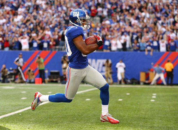 EAST RUTHERFORD, NJ - OCTOBER 21:  Victor Cruz #80 of the New York Giants scores the winning touchdown against the Washington Redskins in the fourth quarter of a 27-23 Giant win  at MetLife Stadium on October 21, 2012 in East Rutherford, New Jersey.  (Photo by Al Bello/Getty Images)