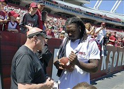 Apr 13, 2013; Columbia, SC, USA; South Carolina Gamecocks defensive end Jadeveon Clowney (7) signs a autograph for fan during the spring game at Williams-Brice Stadium. Mandatory Credit: Curtis Wilson-USA TODAY Sports