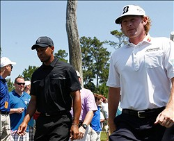 May 10, 2013; Ponte Vedra Beach, FL, USA; Tiger Woods (left) and Brandt Snedeker walk the 18th fairway during the second round of the Players Championship at TPC Sawgrass. Mandatory Credit: Debby Wong-USA TODAY Sports