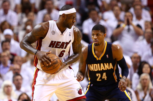 MIAMI, FL - MAY 30:  LeBron James #6 of the Miami Heat handles the ball against Paul George #24 of the Indiana Pacers in the third quarter during Game Five of the Eastern Conference Finals at AmericanAirlines Arena on May 30, 2013 in Miami, Florida. NOTE TO USER: User expressly acknowledges and agrees that, by downloading and or using this photograph, user is consenting to the terms and conditions of the Getty Images License Agreement.  (Photo by Streeter Lecka/Getty Images)