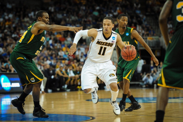OMAHA, NE - MARCH 16: Michael Dixon #11 of the Missouri Tigers moves the ball through the Norfolk State Spartans during the second round of the NCAA Mens Basketball Tournament at CenturyLink Center March 16, 2012 in Omaha, Nebraska. (Photo by Eric Francis/Getty Images)