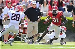 Apr 6, 2013; Athens, GA, USA; Georgia Bulldogs red team receiver Chris Conley (31) runs with the ball after a catch  during the Georgia Spring Day Game at Sanford Stadium. The black team defeated the red team 23-17. Mandatory Credit: Dale Zanine-USA TODAY Sports