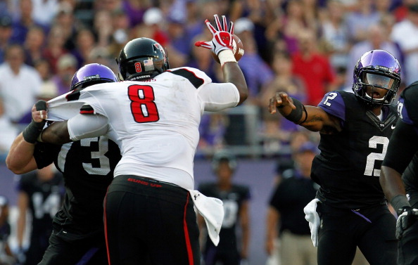 FORT WORTH, TX - OCTOBER 20:  Trevone Boykin #2 of the TCU Horned Frogs has a pass broken up by Delvon Simmons #8 of the Texas Tech Red Raiders at Amon G. Carter Stadium on October 20, 2012 in Fort Worth, Texas. The Texas Tech Red Raiders beat the TCU Horned Frogs 56-53 in triple overtime. (Photo by Tom Pennington/Getty Images)