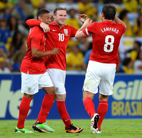 RIO DE JANEIRO, BRAZIL - JUNE 02: Wayne Rooney of England celebrates scorong the second goal with Alex Oxlade Chamberlain and Frank Lampard during the International Friendly match between England and Brazil at Maracana on June 2, 2013 in Rio de Janeiro, Brazil.  (Photo by Laurence Griffiths/Getty Images)