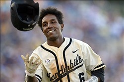 May 26, 2013; Hoover, AL, USA; Vanderbilt Commodores infielder Tony Kemp (6) tosses his helmet after grounding out in the tenth inning against the LSU Tigers during the championship game of the SEC baseball tournament at the Hoover Met. LSU defeated Vanderbilt 5-4 in 11 innings.  Mandatory Credit: John David Mercer-USA TODAY Sports