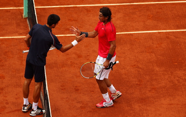 PARIS, FRANCE - JUNE 11:  Rafael Nadal (R) of Spain is congratulated by Novak Djokovic of Serbia after the men's singles final during day 16 of the French Open at Roland Garros on June 11, 2012 in Paris, France.  (Photo by Clive Brunskill/Getty Images)
