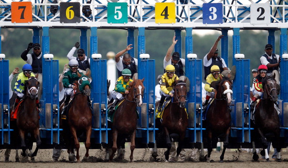 ELMONT, NY - JUNE 09: Horses break from the gate during the start of the 144th Belmont Stakes at Belmont Park on June 9, 2012 in Elmont, New York.  (Photo by Rob Carr/Getty Images)