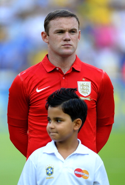 RIO DE JANEIRO, BRAZIL - JUNE 02: Wayne Rooney of England lines up for the national anthem during the International Friendly match between England and Brazil at Maracana on June 2, 2013 in Rio de Janeiro, Brazil.  (Photo by Laurence Griffiths/Getty Images)