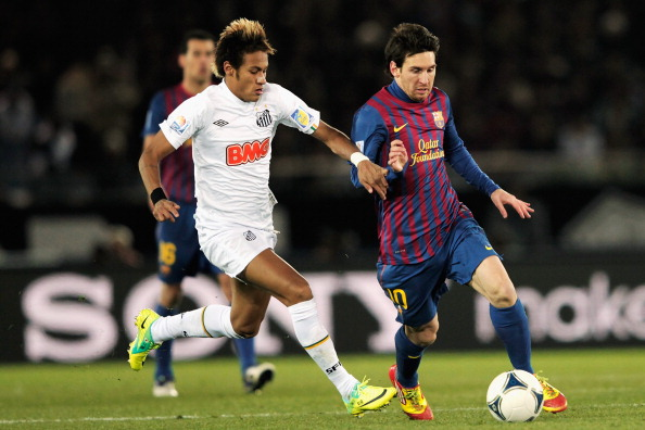 YOKOHAMA, JAPAN - DECEMBER 18: Lionel Messi (R) of Barcelona is challenged by Neymar of Santos during the FIFA Club World Cup Final match between Santosl and Barcelona at the Yokohama International Stadium on December 18, 2011 in Yokohama, Japan.  (Photo by Lintao Zhang/Getty Images)