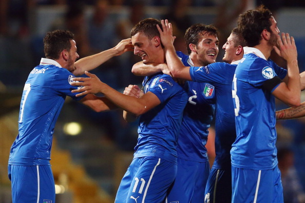 TEL AVIV, ISRAEL - JUNE 08:  Manolo Gabbiadini (2L) of Italy celebrates his team's third goal with team mate Alessandro Florenzi during the UEFA European U21 Championship Group A match between Italy and Israel at Bloomfield Stadium on June 8, 2013 in Tel Aviv, Israel.  (Photo by Alex Grimm/Getty Images)