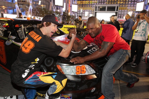 LOS ANGELES, CA - JANUARY 21:  Travis Pastrana (L) and Quinton 'Rampage' Jackson arm wrestle at the Pastrana-Waltrip Racing announcement of the 2011 NASCAR Nationwide partnership on January 21, 2011 in Los Angeles, California.  (Photo by Noel Vasquez/Getty Images for Waltrip Racing)