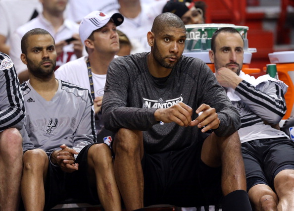 MIAMI, FL - JUNE 09:  Tony Parker #9, Tim Duncan #21 and Manu Ginobili #20 of the San Antonio Spurs sit on the bench late in the fourth quarter while taking on the Miami Heat during Game Two of the 2013 NBA Finals at AmericanAirlines Arena on June 9, 2013 in Miami, Florida. NOTE TO USER: User expressly acknowledges and agrees that, by downloading and or using this photograph, User is consenting to the terms and conditions of the Getty Images License Agreement.  (Photo by Christian Petersen/Getty Images)