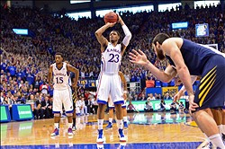 Mar 2, 2013; Lawrence, KS, USA; Kansas Jayhawks guard Ben McLemore (23) shoots a foul shot against the West Virginia Mountaineers during the first half at Allen Fieldhouse. Kansas defeated West Virginia 91-65.  Mandatory Credit: Peter G. Aiken-USA TODAY Sports