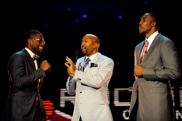PHOENIX - FEBRUARY 13:  Assistant coach Dwyane Wade of the Rookie team, TV personality Kenny Smith and assistant coach Dwight Howard of the Sophomore team talk before the T-Mobile Rookie Challenge & Youth Jam part of 2009 NBA All-Star Weekend at US Airways Center on February 13, 2009 in Phoenix, Arizona.  NOTE TO USER: User expressly acknowledges and agrees that, by downloading and or using this photograph, User is consenting to the terms and conditions of the Getty Images License Agreement.  (Photo by Kevork Djansezian/Getty Images)