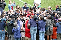 Jun 11, 2013; Foxborough, MA, USA; The media surround New England Patriots quarterback Tim Tebow following Minicamp at Gillette Stadium. Mandatory Credit: Stew Milne-USA TODAY Sports