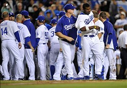 June 11, 2013; Los Angeles, CA, USA; Los Angeles Dodgers right fielder Yasiel Puig (66) leaves with batting coach Mark McGwire (12) after the Dodgers bench confronts the Arizona Diamondbacks bench during the seventh inning at Dodger Stadium. Mandatory Credit: Gary A. Vasquez-USA TODAY Sports