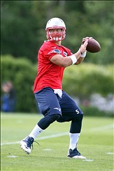 Jun 12, 2013; Foxborough, MA, USA; New England Patriots quarterback Tim Tebow passes the ball during minicamp at the practice fields of Gillette Stadium. Mandatory Credit: Stew Milne-USA TODAY Sports