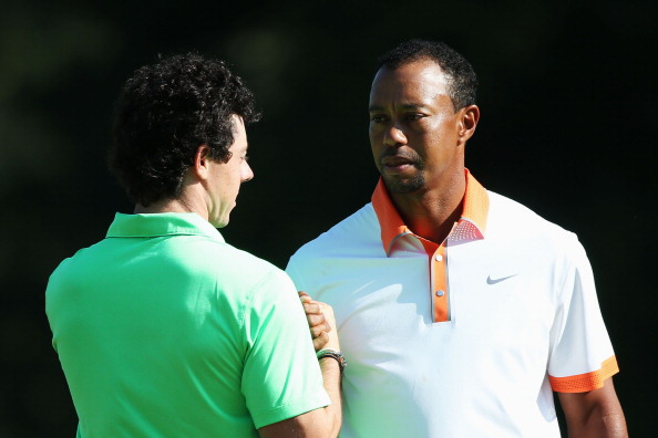 ARDMORE, PA - JUNE 12:  (L-R) Rory McIlroy of Northern Ireland and Tiger Woods of the United States shake hands after finishing their practice round prior to the start of the 113th U.S. Open at Merion Golf Club on June 12, 2013 in Ardmore, Pennsylvania.  (Photo by Andrew Redington/Getty Images)