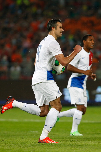 BEIJING, CHINA - JUNE 11:  Robin van Persie (L) of Netherlands celebrates scoring their first goal during the international friendly soccer match at Beijing Workers' Stadium on June 11, 2013 in Beijing, China.  (Photo by Lintao Zhang/Getty Images)