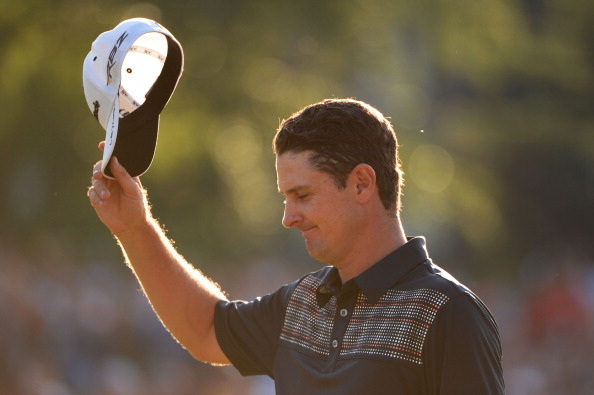 ARDMORE, PA - JUNE 16:  Justin Rose of England tips his hat after putting on the 18th hole to complete the final round of the 113th U.S. Open at Merion Golf Club on June 16, 2013 in Ardmore, Pennsylvania.  (Photo by Ross Kinnaird/Getty Images)