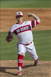 Jun 8, 2013; Raleigh, NC, USA; North Carolina State Wolfpack pitcher Carlos Rodon delivers a pitch against the Rice Owls during the Raleigh super regional of the 2013 NCAA baseball tournament at Doak Field. North Carolina State defeated Rice 4-3. Mandatory Credit: Jeremy Brevard-USA TODAY Sports