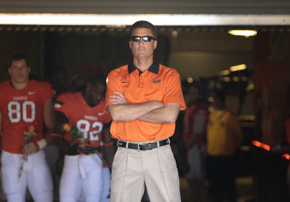 STILLWATER, OK - NOVEMBER 17:   Head Coach Mike Gundy of the Oklahoma State Cowboys waits in the tunnel before the game against the Texas Tech Red Raiders November 17, 2012 at Boone Pickens Stadium in Stillwater, Oklahoma. Oklahoma State defeated Texas Tech 59-21. (Photo by Brett Deering/Getty Images)