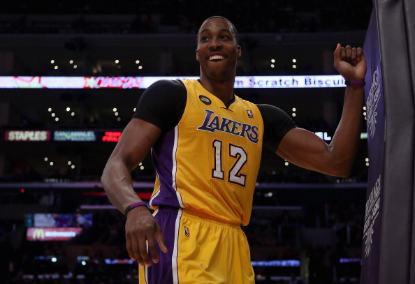 LOS ANGELES, CA - FEBRUARY 22:  Dwight Howard #12 of the Los Angeles Lakers smiles after being fouled in the first half against the Portland Trail Blazers at Staples Center on February 22, 2013 in Los Angeles, California. NOTE TO USER: User expressly acknowledges and agrees that, by downloading and or using this photograph, User is consenting to the terms and conditions of the Getty Images License Agreement.  (Photo by Jeff Gross/Getty Images)
