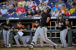 Jun 19, 2013; Omaha, NE, USA; Oregon State Beavers outfielder Michael Conforto (8) hits during their College World Series game against the Indiana Hoosiers at TD Ameritrade Park. Mandatory Credit: Dave Weaver-USA Today Sports