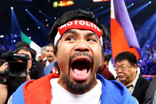 LAS VEGAS, NV - DECEMBER 08:  Manny Pacquiao screams in the ring before taking on Juan Manuel Marquez during their welterweight bout at the MGM Grand Garden Arena on December 8, 2012 in Las Vegas, Nevada.  (Photo by Al Bello/Getty Images)