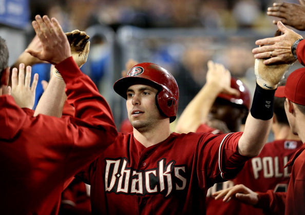 LOS ANGELES, CA - MAY 08:  Paul Goldschmidt #44 of the Arizona Diamondbacks celebrates with teammates in the dugout after hitting a two run home run in the sixth inning against the Los Angeles Dodgers at Dodger Stadium on May 8, 2013 in Los Angeles, California.  (Photo by Stephen Dunn/Getty Images)
