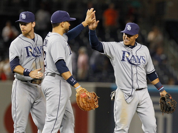 NEW YORK, NY - JUNE 20:  Desmond Jennings #8 of the Tampa Bay Rays celebrates with teammates James Loney #21 and Ben Zobrist #18 after defeting the New York Yankees at Yankee Stadium on June 20, 2013 in the Bronx borough of New York City. Rays defeated the Yankees 8-3. (Photo by Mike Stobe/Getty Images)