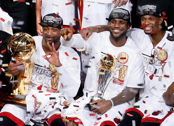 MIAMI, FL - JUNE 20:  Dwyane Wade #3, LeBron James #6 and Chris Bosh #1 of the Miami Heat celebrate after defeating the San Antonio Spurs 95-88 to win Game Seven of the 2013 NBA Finals at AmericanAirlines Arena on June 20, 2013 in Miami, Florida. NOTE TO USER: User expressly acknowledges and agrees that, by downloading and or using this photograph, User is consenting to the terms and conditions of the Getty Images License Agreement.  (Photo by Kevin C. Cox/Getty Images)