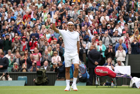 LONDON, ENGLAND - JUNE 24:  Roger Federer of Switzerland celebrates match point during his gentlemen's singles first round match against Victor Hanescu of Romania on day one of the Wimbledon Lawn Tennis Championships at the All England Lawn Tennis and Croquet Club on June 24, 2013 in London, England.  (Photo by Clive Brunskill/Getty Images)