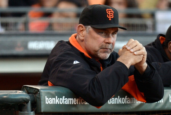 SAN FRANCISCO, CA - JUNE 21:  Manager Bruce Bochy #15 of the San Francisco Giants looks on from the dugout against the Miami Marlins at AT&T Park on June 21, 2013 in San Francisco, California.  (Photo by Thearon W. Henderson/Getty Images)