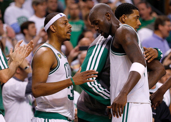 BOSTON, MA - MAY 3:  Paul Pierce #34 of the Boston Celtics and Kevin Garnett #5 exchange words in the final moment in the 4th quarter in Game Six of the Eastern Conference Quarterfinals of the 2013 NBA Playoffs on May 3, 2013 at TD Garden in Boston, Massachusetts. The Celtics lost 88-80. NOTE TO USER: User expressly acknowledges and agrees that, by downloading and or using this photograph, User is consenting to the terms and conditions of the Getty Images License Agreement. (Photo by Jim Rogash/Getty Images)