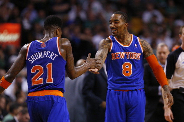 BOSTON, MA - MAY 3:  Iman Shumpert #21 and J.R. Smith #8 of the New York Knicks  react during a time out in the 4th quarter as they defeat the Celtics 88-80 in Game Six of the Eastern Conference Quarterfinals of the 2013 NBA Playoffs on May 3, 2013 at TD Garden in Boston, Massachusetts. NOTE TO USER: User expressly acknowledges and agrees that, by downloading and or using this photograph, User is consenting to the terms and conditions of the Getty Images License Agreement. (Photo by Jim Rogash/Getty Images)
