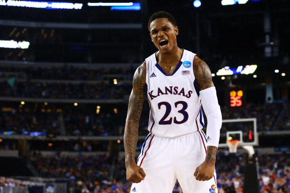 ARLINGTON, TX - MARCH 29:  Ben McLemore #23 of the Kansas Jayhawks reacts in the second half against the Kansas Jayhawks during the South Regional Semifinal round of the 2013 NCAA Men's Basketball Tournament at Dallas Cowboys Stadium on March 29, 2013 in Arlington, Texas.  (Photo by Ronald Martinez/Getty Images)