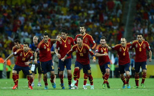 FORTALEZA, BRAZIL - JUNE 27:  Sergio Ramos of Spain and his team-mates celebrate after Jesus Navas scored the winning penalty in a shootout during the FIFA Confederations Cup Brazil 2013 Semi Final match between Spain and Italy at Castelao on June 27, 2013 in Fortaleza, Brazil.  (Photo by Robert Cianflone/Getty Images)