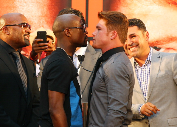 NEW YORK, NY - JUNE 24:  Floyd Mayweather and Canelo Alvarez face-off during a news conference at the Pedestrian Walk in Times Square on June 24, 2013 in New York City. Floyd Mayweather and Canelo Alvarez are scheduled to fight September 14 at the MGM Grand in Las Vegas, Nevada to unifty their junior middleweight world titles.  (Photo by Mike Stobe/Getty Images)