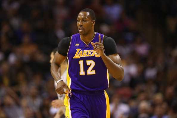 SAN ANTONIO, TX - APRIL 24:  Dwight Howard #12 of the Los Angeles Lakers during Game Two of the Western Conference Quarterfinals of the 2013 NBA Playoffs at AT&T Center on April 24, 2013 in San Antonio, Texas. NOTE TO USER: User expressly acknowledges and agrees that, by downloading and or using this photograph, User is consenting to the terms and conditions of the Getty Images License Agreement.  (Photo by Ronald Martinez/Getty Images)