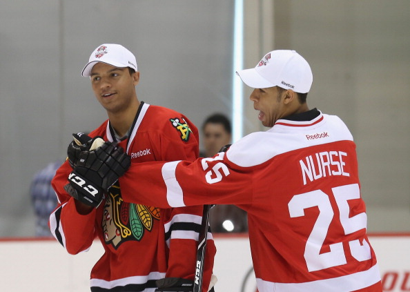 NEWARK, NJ - JUNE 29: (L-R) Seth Jones and Darnell Nurse clown around during a skate with members of the Hockey in Newark youth program and the New Jersey Rockets at the AmeriHealth Pavilion inside the Prudential Center on June 29, 2013 in Newark, New Jersey.  (Photo by Bruce Bennett/Getty Images)