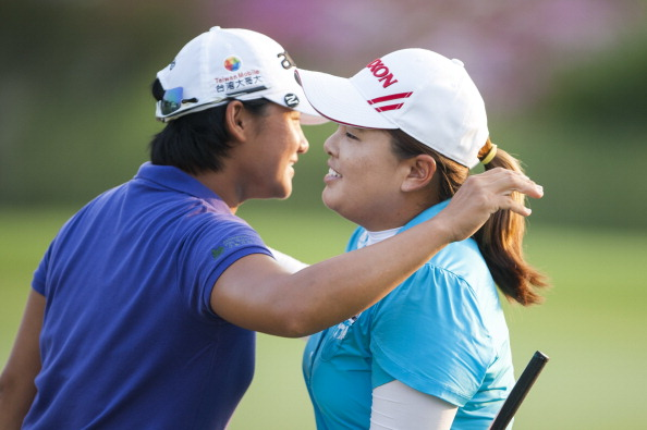 TAOYUAN, TAIWAN - OCTOBER 26:  Yani Tseng of Taiwan and Inbee Park of South Korea embraces on the 18th hole during the day two of the Sunrise LPGA Taiwan Championship at the Sunrise Golf Course on October 26, 2012 in Taoyuan, Taiwan.  (Photo by Victor Fraile/Getty Images)