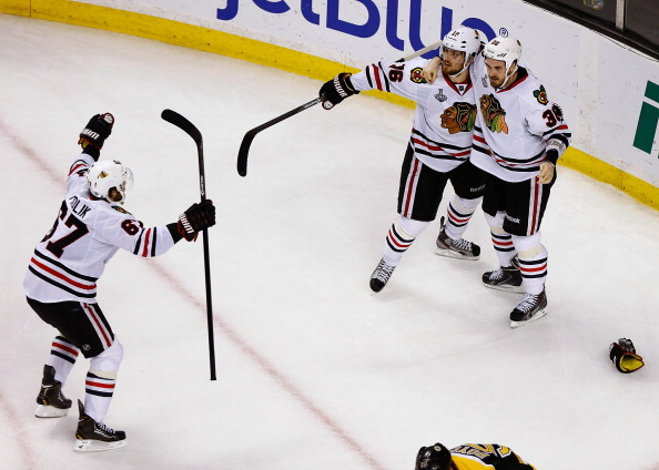 BOSTON, MA - JUNE 24: Dave Bolland #36 celebrates with teammates Marcus Kruger #16 and Michael Frolik #67 of the Chicago Blackhawks after scoring the game-winning goal in the third period against the Boston Bruins during Game Six of the Stanley Cup Final on June 24, 2013 at TD Garden in Boston, Massachusetts. (Photo by Jared Wickerham/Getty Images)