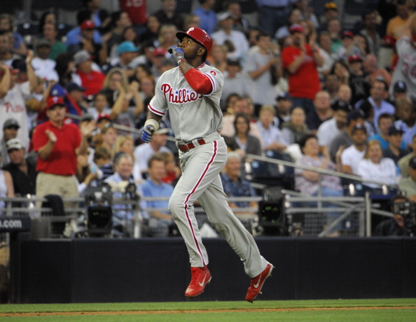 SAN DIEGO, CA - JUNE 25:  Domonic Brown #9 of the Philadelphia Phillies looks skyward after hitting a three-run homer during the third inning of a baseball game against the San Diego Padres at Petco Park on June 25, 2013 in San Diego, California.  (Photo by Denis Poroy/Getty Images)