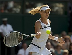 Jul 4, 2013; London, United Kingdom;  Agnieszka Radwanska (POL) during her match against Sabine Lisicki (GER) on day 10 of the 2013 Wimbledon Championships at the All England Lawn Tennis Club. Mandatory Credit: Susan Mullane-USA TODAY Sports