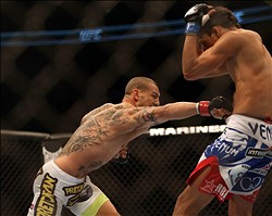 September 22, 2012; Toronto, ON, CANADA; Cub Swanson (left) punches Charles Oliveira during the featherweights fight at UFC 152 at the Air Canada Centre. Mandatory Credit: Tom Szczerbowski-USA TODAY Sports
