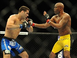 Jul 6, 2013; Las Vegas, NV, USA;  Chris Weidman, blue shorts, defeated Anderson Silva (yellow shorts) in the second round with a TKO in their Middleweight Chamionship Bout at the MGM Grand Garden Arena. Mandatory Credit: Jayne Kamin-Oncea-USA TODAY Sports